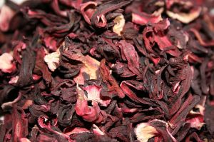 Dried hibiscus sepals, pink and dark purple in color