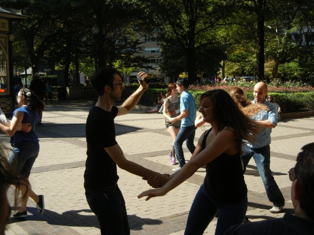 People dancing lindy hop outdoors