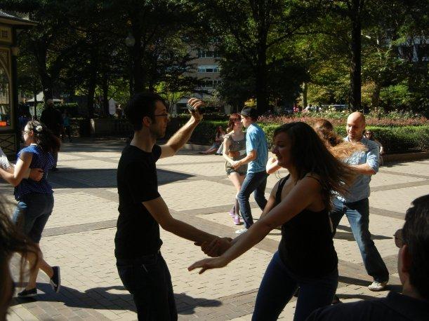 People dancing lindy hop outdoors