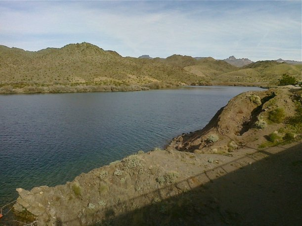 Lake mead, with dry hillsides and dark blue water