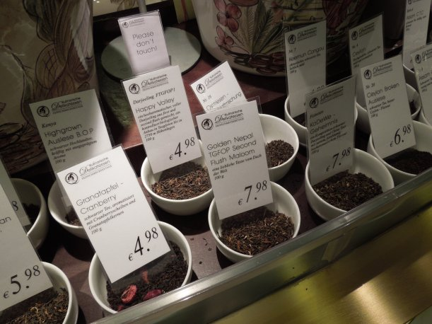A counter with tea samples set out in dishes